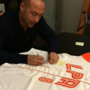 NY Yankees' Derek Jeter signs uniform of deceased LPA player Christian Medina